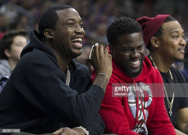 HipHop artist Meek Mill and comedian Kevin Hart look on during the game between the Houston Rockets and Philadelphia 76ers at the Wells Fargo Center...