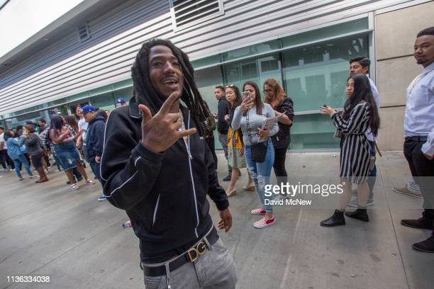 Hiphop artist Mozzy is greeted by fans as he attends a memorial celebration for slain rapper Nipsey Hussle at the STAPLES Center arena on April 11...