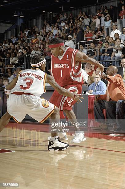 Hiphop artist Nelly of team HTown dribbles the ball against rapper Bow Wow of team Clutch City at the McDonald's NBA AllStar Celebrity Game during...