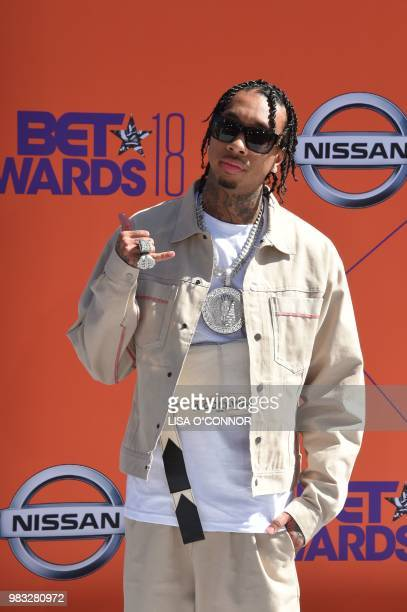 US hiphop artist Tyga poses upon arrival for the BET Awards at Microsoft Theatre in Los Angeles California on June 24 2018