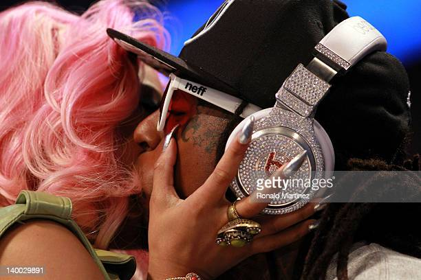 Hiphop artists Lil' Wayne wearing diamond studded beats headphones by Dr Dre greets Nicki Minaj during the 2012 NBA AllStar Game at the Amway Center...
