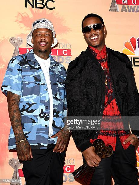 Hiphop artists YG and Jeremih winners of the Hip Hop/RB Song of the Year Award for 'Don't Tell 'Em' pose in the press room during the 2015...