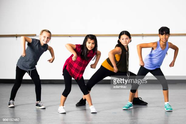 hip-hop dance group of young diverse girls - hip hop music stock pictures, royalty-free photos & images