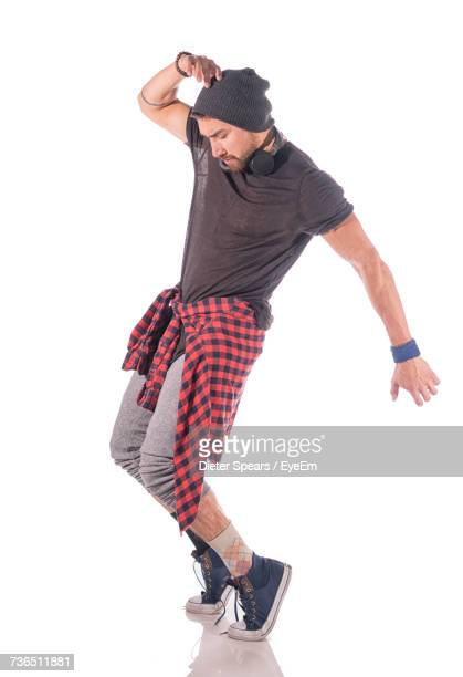 hip-hop dancer dancing against white background - man dancing stock pictures, royalty-free photos & images
