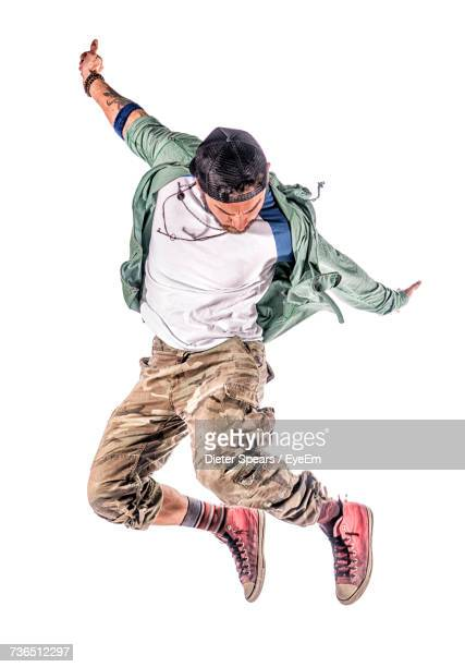 hip-hop dancer jumping against white background - man dancing stock pictures, royalty-free photos & images