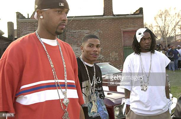 Hip-hop performer Nelly, center, walks with his group, St. Lunatics, March 23, 2001 during a video shoot for a music video to accompany his new...