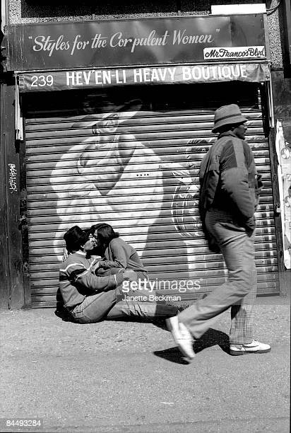Hiphop pioneer King Sun engages in a public display of affection on 125th street in Harlem New York 1987