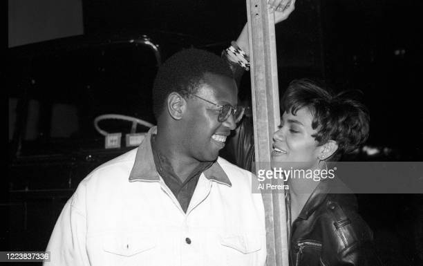 HipHop Producer Andre Harrell relaxes on the set of Strictly Business by chatting with Halle Berry on May 12 1991 in New York City