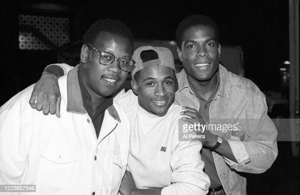 HipHop Producer Andre Harrell relaxes on the set of Strictly Business by chatting with Tommy Davidson and Joseph C Phillips on May 12 1991 in New...