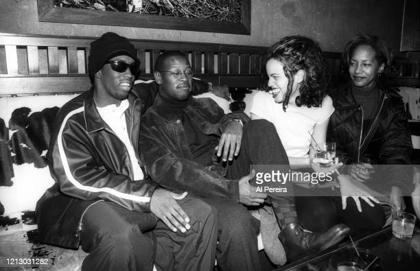"""Hip-Hop Producer/Executive/Label Head Andre Harrell relaxes in a nightclub VIP area by chatting with Sean """"Puffy"""" Combs, record label executive..."""