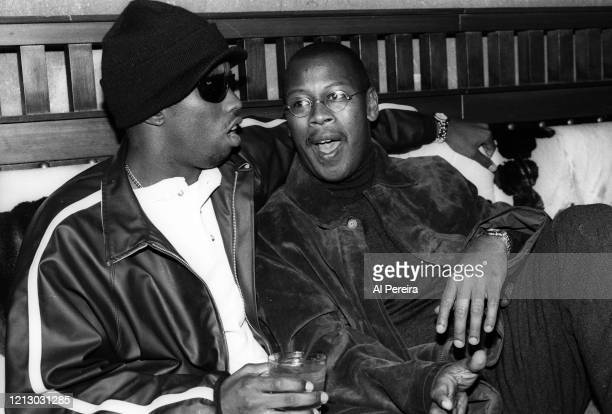 """Hip-Hop Producer/Executive/Label Head Andre Harrell relaxes in a nightclub VIP area by chatting with Sean """"Puffy"""" Combs on November 12, 1994 in New..."""