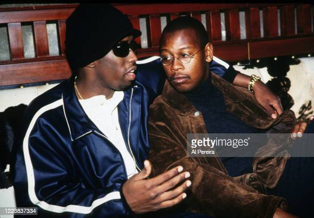 HipHop Producer/Executive/Label Head Andre Harrell relaxes in a nightclub VIP area by chatting with Sean Puffy Combs on November 12 1994 in New York...