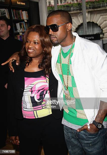 US hiphop star Kanye West poses with his mother Donda prior to signing copies of 'Raising Kanye Life Lessons From The Mother Of A HipHop Superstar'...