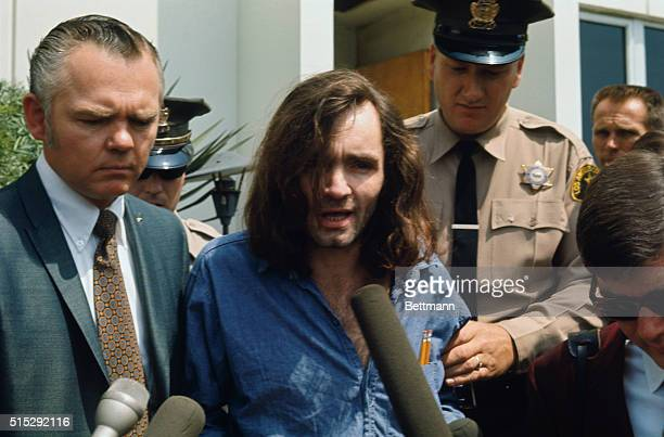 Hippie chieftain Charles Manson speaks with reporters as he is escorted by a deputy sheriff and his lawyer Irving Kanarek from a Santa Monica...