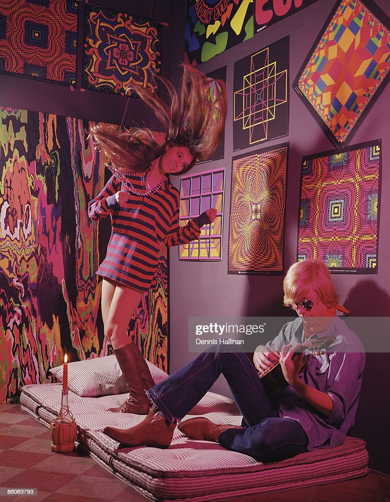 Hippie Couple In Psychedelic Bedroom Playing Guitar And Dancing Stock Photo  | Getty Images