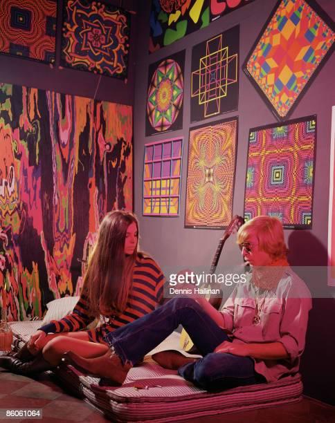 Hippie Couple Smoking in Psychedelic Bedroom