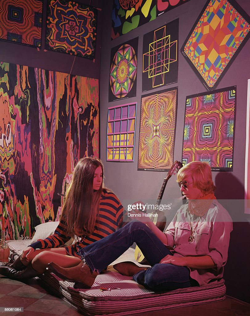 Hippie Couple Smoking In Psychedelic Bedroom Stock Photo | Getty Images