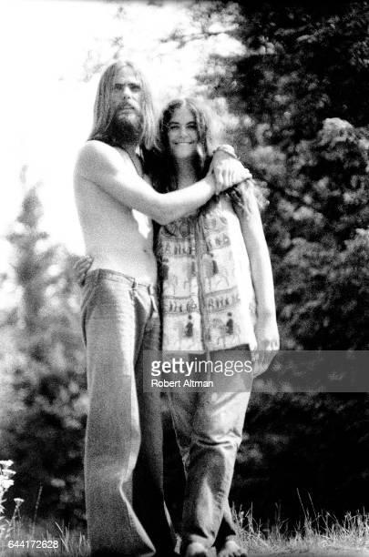 A hippie couple stands on a hill during The Alternative Media Conference on June 1720 1970 at Goddard College in Plainfield Vermont