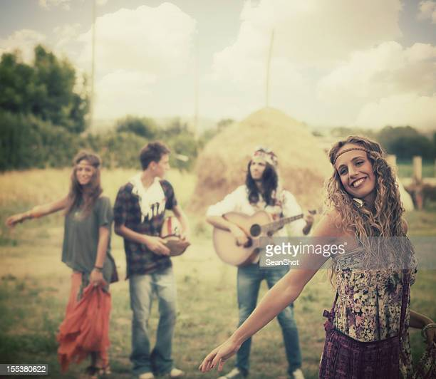 Hippie girl dancing with her friends