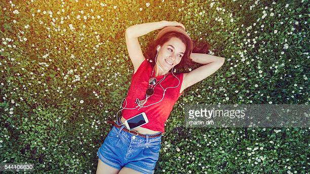 hippie girl lying down in the grass - girls sunbathing stock pictures, royalty-free photos & images