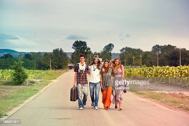 Hippie group walking on the road