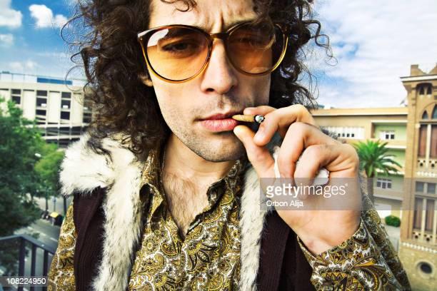 Hippie Man Smoking Marijuana Cigarette Outside