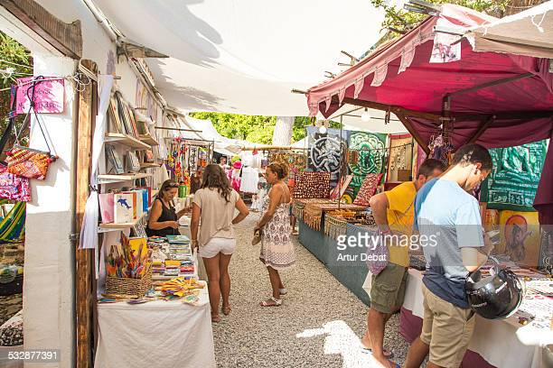 Hippie market in the island of Ibiza with people and sunny day in summer time Balearic Islands Europe