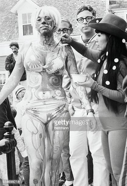 Hippie Martha Melnyk of Philadelphia lets New York artist Yayoi Kusama paint her at a Body Festival in Provincetown Massachusetts