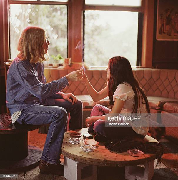 Hippie teenagers smoking in living room