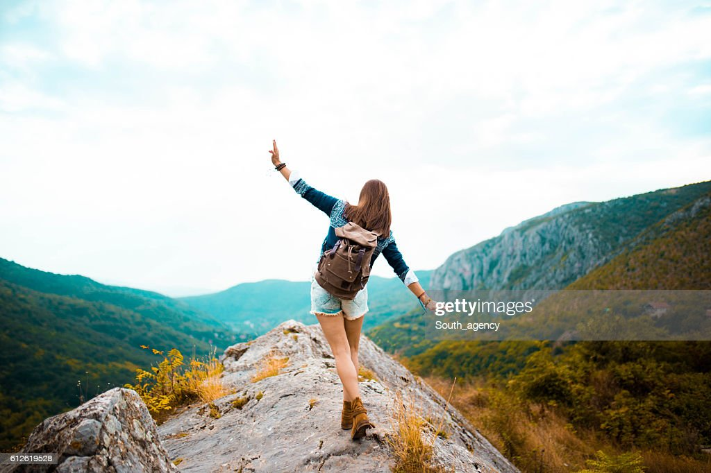 Hippie woman stroll on mountain : Stock Photo