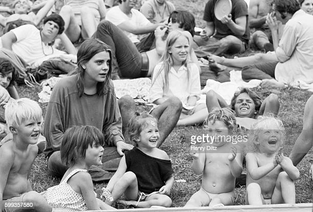 Hippies and their children relax in the grass at the free Woodstock Music and Art Fair The festival took place on Max Yasgur's dairy farm which he...
