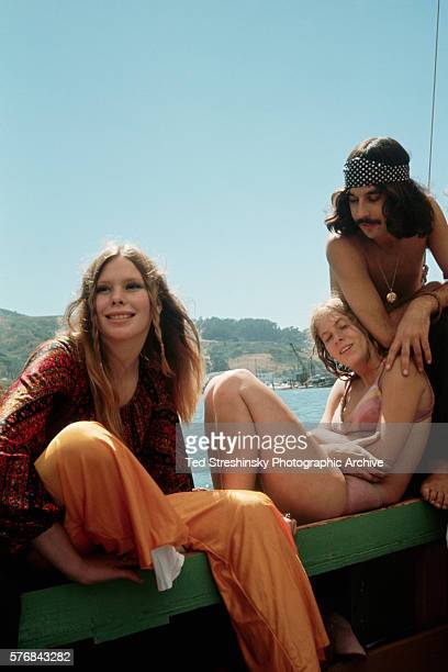 Hippies bask in the sun at a sailboat party hosted by bohemian artist Jean Varda on San Francisco Bay Time magazine covered the party which took...
