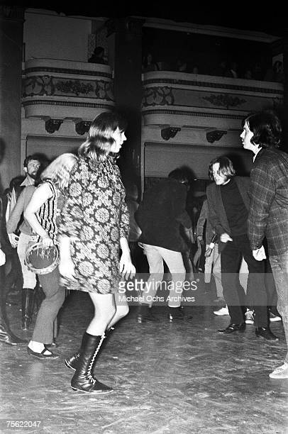 Hippies dance at a psychedelic rock concert at the Fillmore Auditorium in San Francisco California early summer 1967