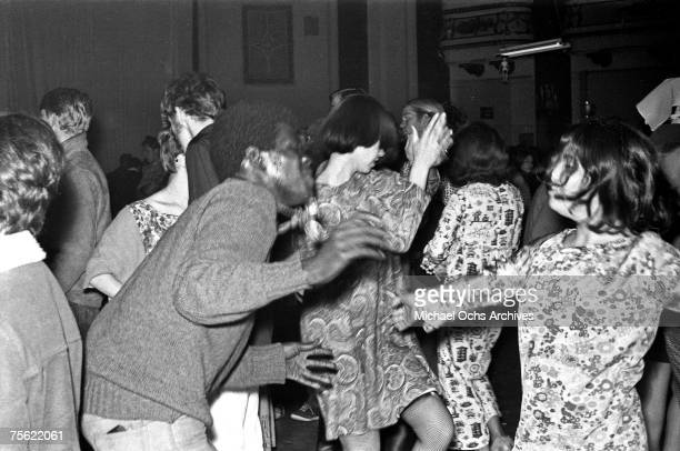 Hippies dance at a psychedelic rock concert at the Fillmore Auditorium in San Francisco California in early summer 1967