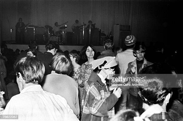 Hippies dance to the psychedelic stylings of a local rock band at the Fillmore Auditorium in San Francisco California in early summer 1967