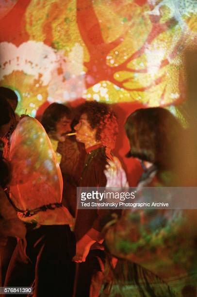Hippies Dancing in Psychedelic Club