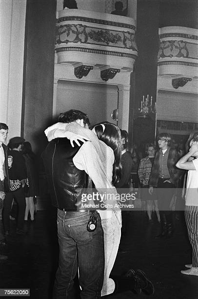 Hippies find a way to pass the time before the music starts at a psychedelic rock concert at the Fillmore Auditorium in San Francisco California in...
