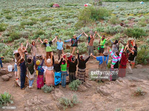 Hippies forming a Supper Circle at a US Rainbow Family Gathering. Supper Circles like this one are formed to pray and give thanks before eating...