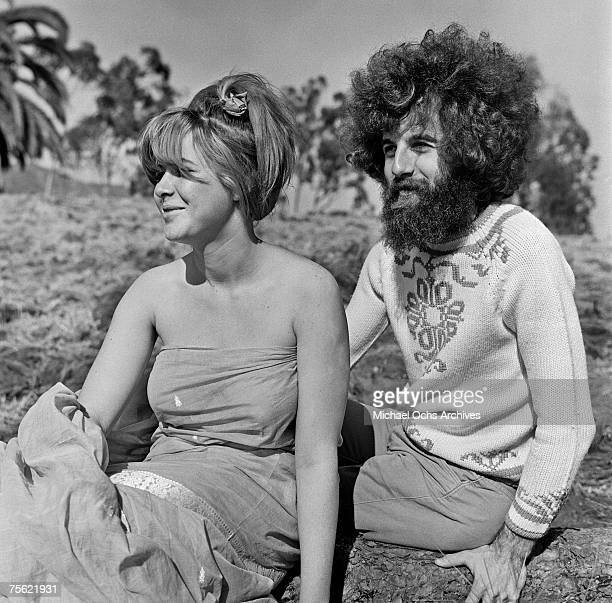Hippies or 'freaks' as they prefer to be called relax under the sun in an open field in Los Angeles California in summer 1967