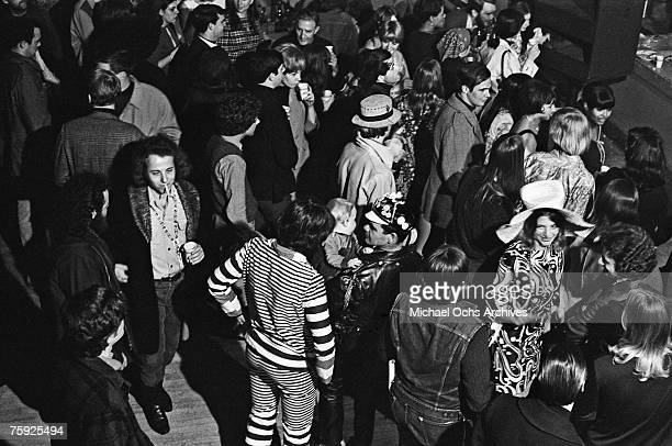 Hippies wait for a rock concert to start in early summer at the Fillmore Auditorium in San Francisco California
