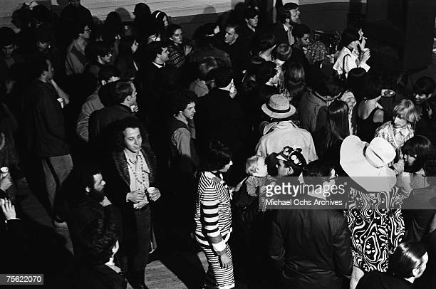 Hippies wait for the concert to start at the Fillmore Auditorium in San Francisco California in early summer 1967