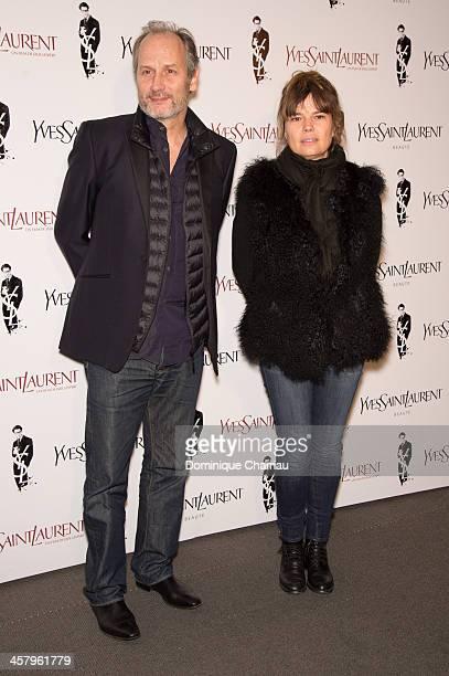 Hippolyte Girardot and his wife Kristina Larsen attend the 'Yves Saint Laurent' Paris Premiere at Cinema UGC Normandie on December 19, 2013 in Paris,...