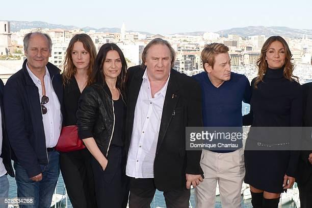 Hippolyte Girardot Stephane Caillard Geraldine Pailhas Gerard Depardieu Benoit Magimel and Nadia Fares attend the 'Marseille' Netflix TV Serie Wold...
