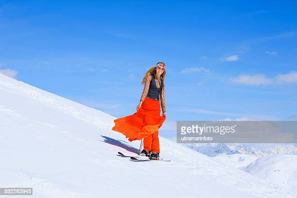 Hippy  Beautiful blonde young woman   Telemark snow skier    Ski vacation