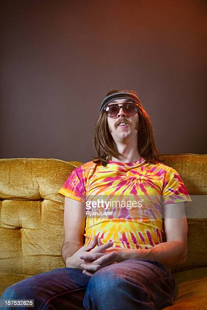 Hippy Man Sitting on Vintage Couch