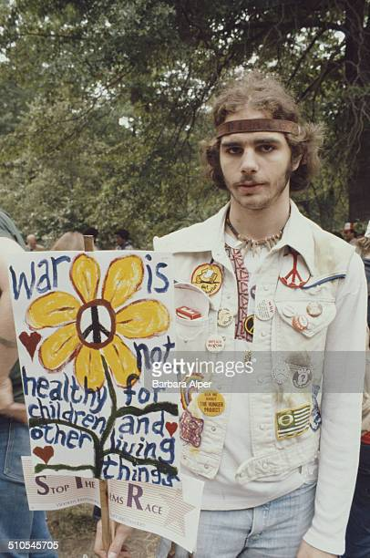 A hippy with a handpainted sign at an antinuclear rally in Central Park New York City 12th June 1982