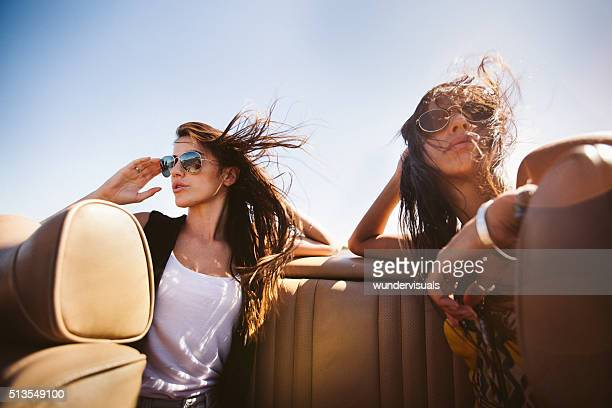 Hipster boho girl friends enjoys a summer road trip