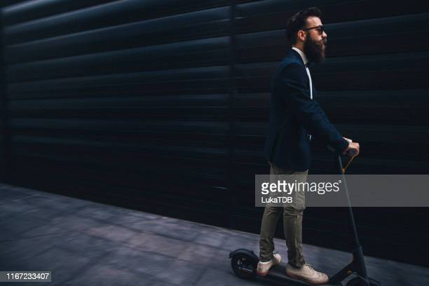 handsome young bearded man suit riding