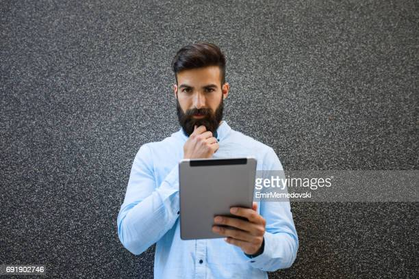 hipster businessman with digital tablet - emir memedovski stock pictures, royalty-free photos & images