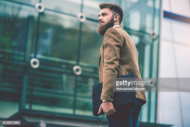 Hipster Businessman with Laptop Bag Walking on the City Street